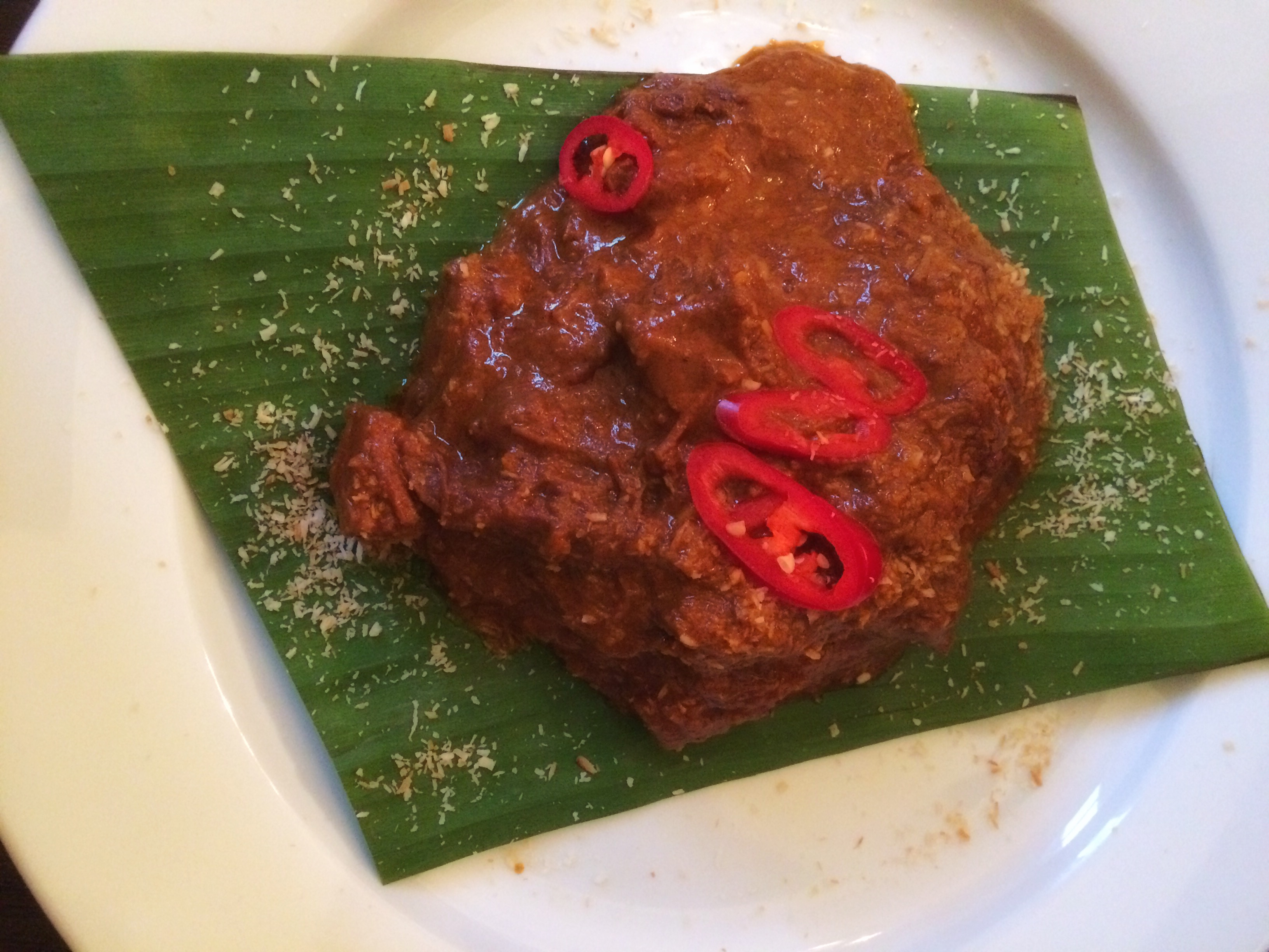 Beef Rendang Although We Were Both Quite Full I Opted To Have A Traditional Indonesian Desert Of Pandan Pancakes Which Were Filled With Palm Sugar And